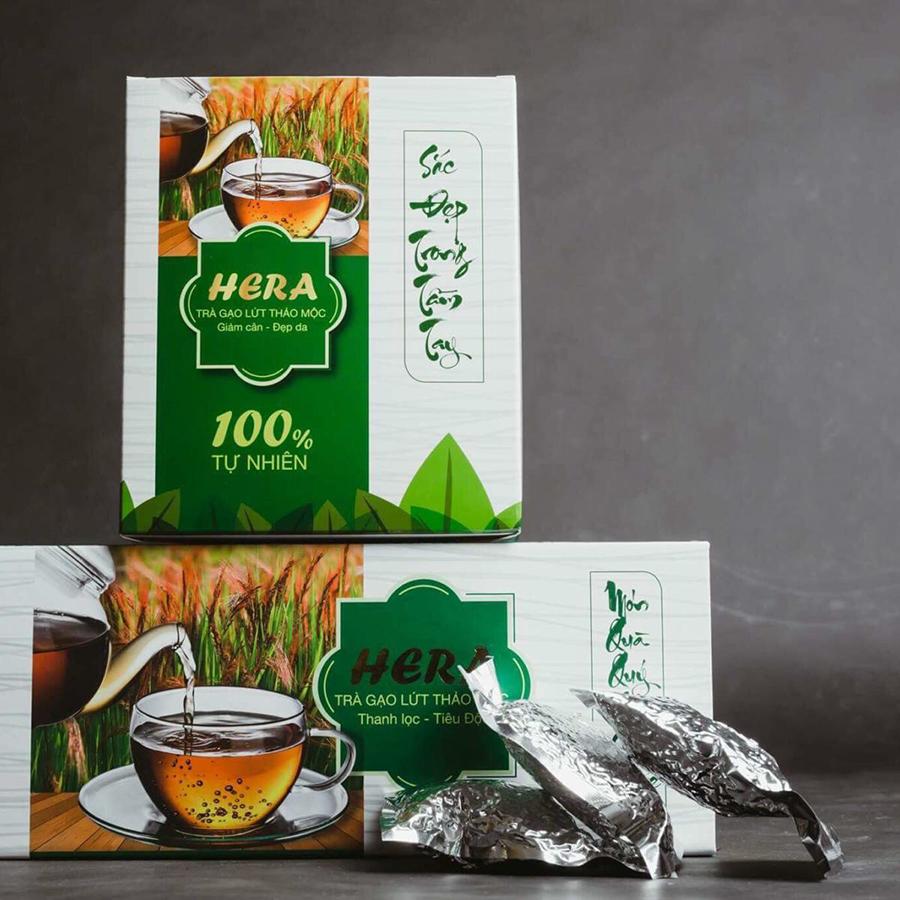 In hộp giấy trà giảm cân HERA gạo lứt được Lạc Hồng thiết kế