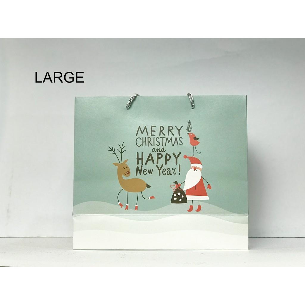 Mẫu túi giấy đựng quà giáng sinh và năm mới.
