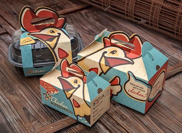 Mẫu in hộp giấy đựng gà rán dễ cầm, nắm vì có thiết kế tay cầm tiện lợi.