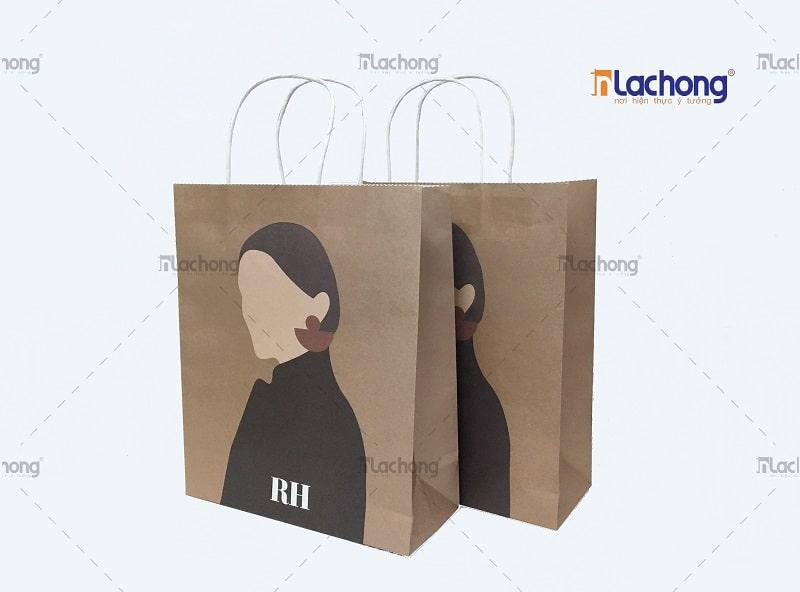 Mẫu túi giấy kraft có quai màu vàng nâu cho shop thời trang do Lạc Hồng sản xuất